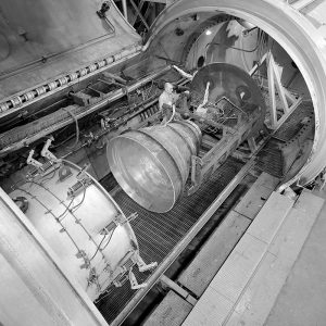 Installation of an Apollo Service Propulsion System contour nozzle in PSL No. 2. Researchers were exploring performance of several nozzle shapes for solid rockets. (3/13/1964)