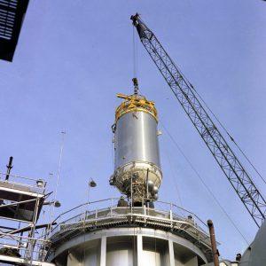 Crane lowers Centaur into test chamber.