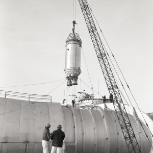 Crane lowering a Centaur rocket into the Space Power Chamber No.1.
