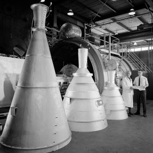 Researchers with several nozzles for solid rockets at PSL.