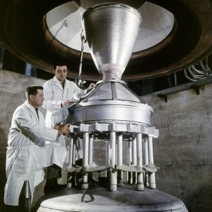 Two technicians work with Kiwi nozzle