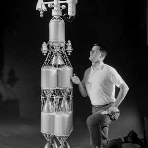 Researcher examines nuclear rocket model.