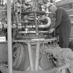 Mechanic working on RETF test stand.