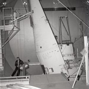 Engineer examins Surveyor faring half after test.