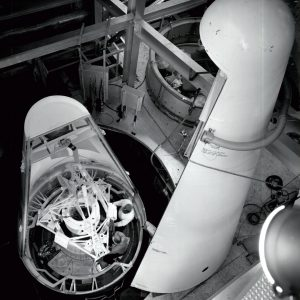View from above as Mechanics install a replica of the Surveyor spacecraft in E Stand