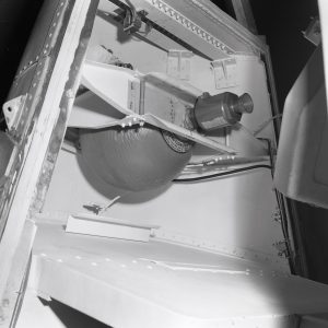 Thruster bottle and nozzle in the tip of the Surveyor nose cone.