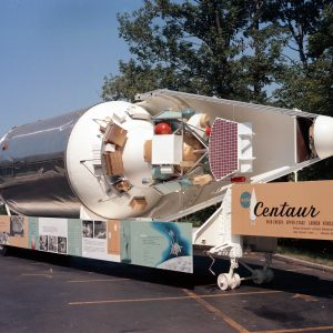 Lifesize model of Centaur rocket with payload visible.