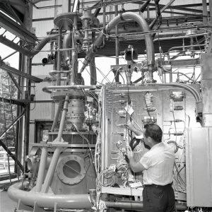 Man working on RETF test stand