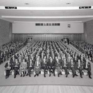 Group seated in auditorium.