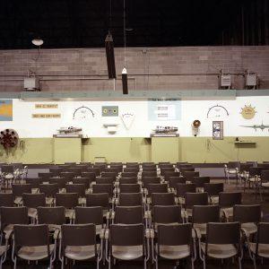 Seats set up in hangar.