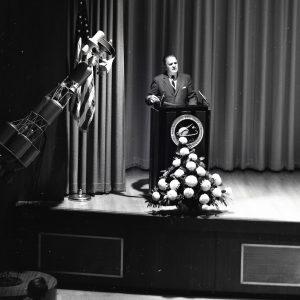 Webb at podium.