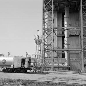 Ground level of the B-3 test stand showing the facility's exhaust line. A railroad tank car is at the left