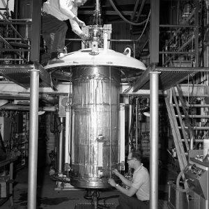 Mechanic peers into vacuum chamber