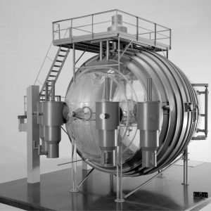 A clear plastic model of the K Site vacuum chamber.