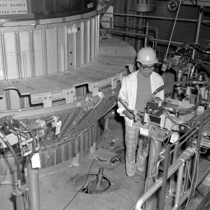 An engineer examines the setup for a test of the Centaur Standard Shroud's in the B-3 test stand