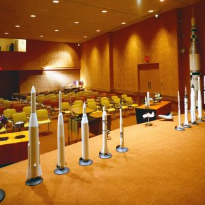 View from stage of auditorium with rocket models.
