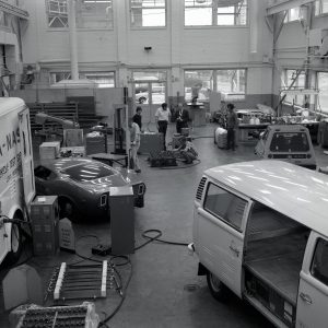 Shop area with various vehicles and equipment.
