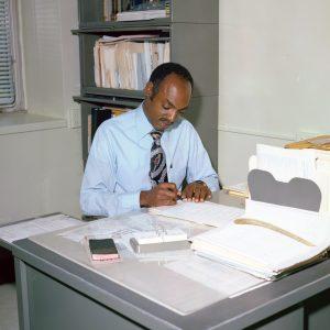 Reid at desk.