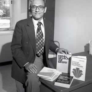 Siegel with books.