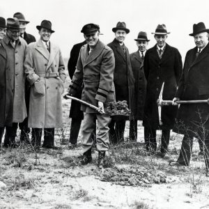 Officials break ground at airport.
