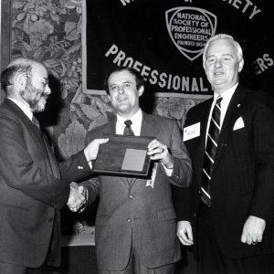 Szabo receiving award.