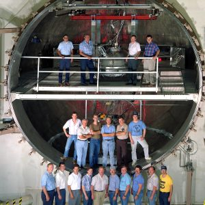 Employees pose in K Site chamber