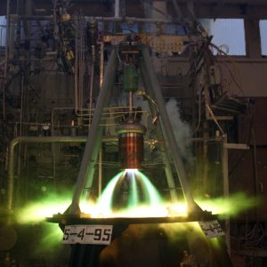 Engine firing greenish flames in RETF stand.