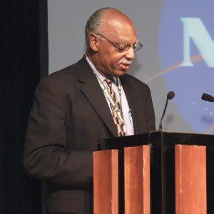 Reid at podium.