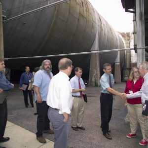 Group of Glenn officials meets with OSHPO beneath the AWT.