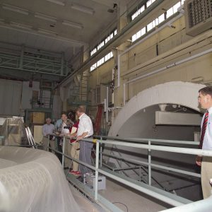 Group examines test section of AWT on tour.