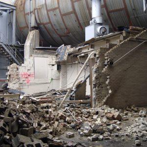 Half destroyed brick pump house.