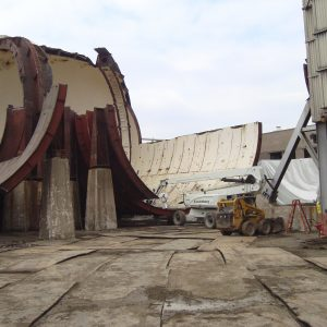 AWT demolition site with steel plates on the ground.