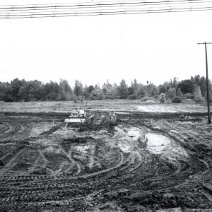 Tractor grades muddy field
