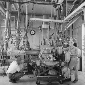 Two mechanics prepare a test rig inside the Pilot Plant