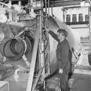 A mechanic inspects the test rig at I Site