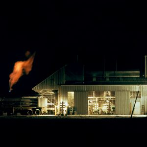C Site at night with a hydrogen burnoff line to the left in 1962