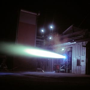 Rocket engine firing horizontally out of J-1 at night