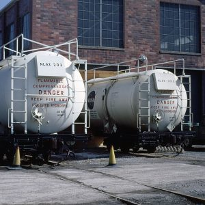 Railcar dewars parked beside the Locomotive Shop