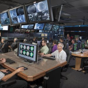 Researchers, engineers and operators monitor a test from the control room of the Propulsion Systems Laboratory (PSL).