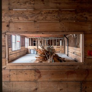 View of wooden interior framing of SPL during demolition