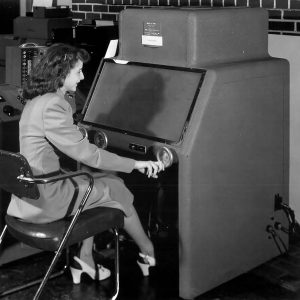 Woman with computing equipment.