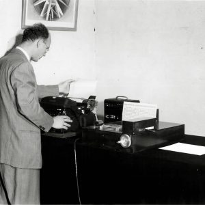 Man with computing equipment.