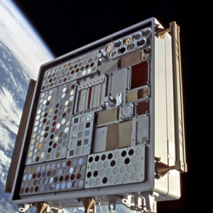 Oblique view of MISSE 2 Tray 1 attached to the ISS airlock after 5.6 months of ram space exposure.
