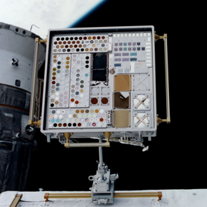 View of MISSE 1 Tray 1 attached to the ISS airlock after 5.6 months of ram space exposure.