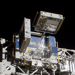 View of MISSE 7A (right) and MISSE 7B (left) on ELC-2 as imaged during EVA 3 shortly after deployment.