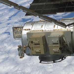 MISSE 2 Tray 1 (ram side) on the ISS Quest Airlock over cloud tops.