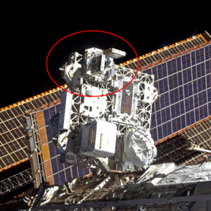 View of MISSE 7A and MISSE 7B on ELC-2 with the S5 and S6 Solar Array Wings (SAW) as imaged during STS-129 / Expedition 21 joint operations shortly after installation.