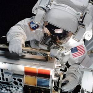 Mission Specialist Patrick Forrester installing MISSE 2 on the ISS Quest Airlock during STS-105 EVA 1.