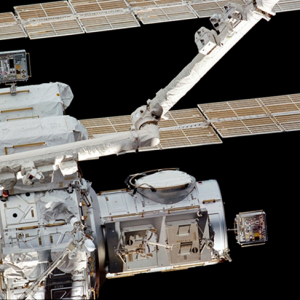 View of MISSE 1 on the High Pressure Gas Tank (top left) and MISSE 2 on the Quest Airlock (lower right) in December 2001.