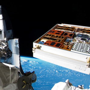 View of the zenith side of MISSE 8 as photographed by NASA astronaut Ron Garan during the July 12, 2011 EVA showing the space shuttle Atlantis in the back ground.